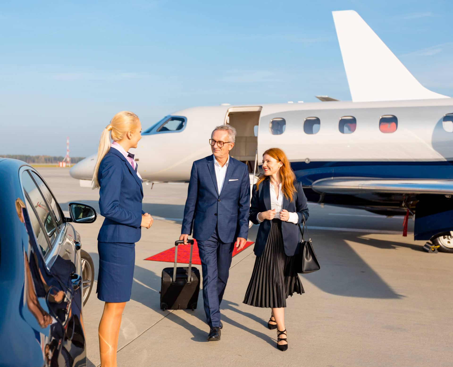 Business people in front of private jet at the airport